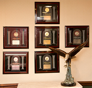 Ambassadors of Excellence award plaques for multiple years of awards from Anheuser Busch